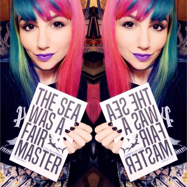 The Sea Was A Fair Master by Calvin Demmer book being held by a girl with purple lipstick and rainbow hair