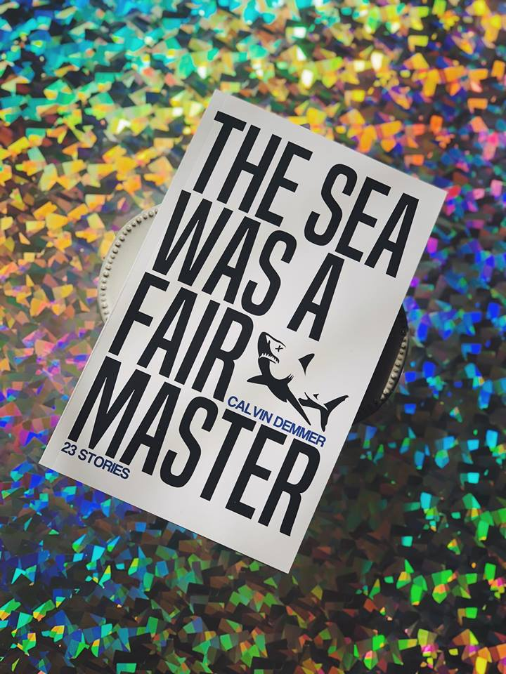 The Sea Was A Fair Master by Calvin Demmer book cover with a rainbow holographic background